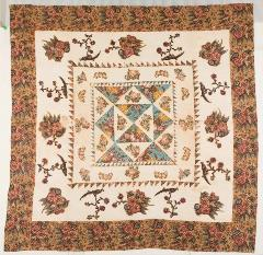 flora and triangular geometric quilt