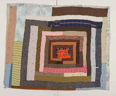 square-shaped colored quilt piece with various patterns