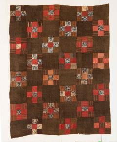 red and brown square-patched quilt