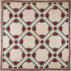teal and green lattice-patterned quilt