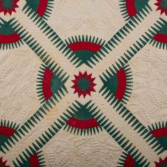 teal, red, and white quilt with floral embroidered pattern